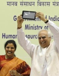 Indias Human Resource Development Minister Kapil Sibal displays the supercheap Aakash Tablet computer